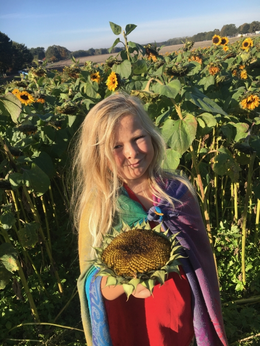 A girl and a sunflower